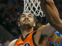Oklahoma City Thunder center Steven Adams (12) and Denver Nuggets forward Kenneth Faried reach for a rebound Sunday in the first half of an NBA basketball game in Oklahoma City.