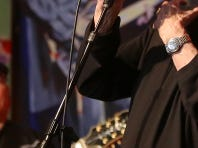 """Rockin' Reggie Vinson sings """"Johnny B. Goode"""" during the International Rockabilly Hall of Fame and Museum's Rockabilly Royalty Christmas Party on Saturday, Dec. 12, 2015."""