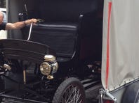 Chris Howell takes pictures with his iPad as his brother, Nick, fiddles with the engine of their 1901 Toledo steam car. The two plan to recreate a historic drive from Flagstaff to the Grand Canyon in the car, which made the same trip in 1902.