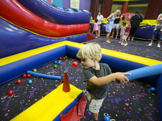 Wyatt Spong, 3, takes a swing at a ball during a birthday