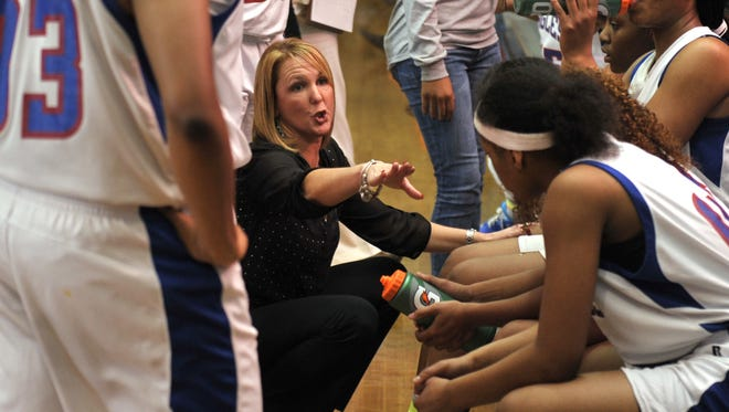 Pine Forest High Lady Eagles head basketball coach Chris Godwin and her team.