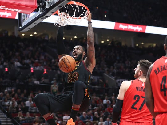 Cleveland Cavaliers forward LeBron James (23) dunks
