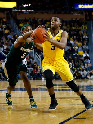 Michigan guard Xavier Simpson (3) goes to the basket against Michigan State on Feb. 7, 2017, at Crisler Center.