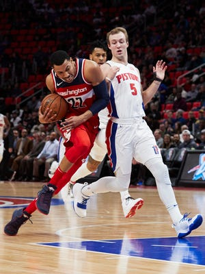 Wizards forward Otto Porter Jr. (22) dribbles the ball around Pistons guard Luke Kennard (5) in the first half on Friday, Jan. 19, 2018, at Little Caesars Arena.