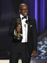 """Courtney B. Vance accepts the award for outstanding lead actor in a limited series or a movie for """"The People v. O.J. Simpson: American Crime Story"""" at the 68th Primetime Emmy Awards on Sunday, Sept. 18, 2016, at the Microsoft Theater in Los Angeles. (Photo by Chris Pizzello/Invision/AP)"""