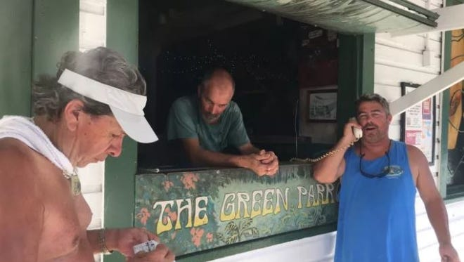 The Green Parrot, one of Key West's iconic dive bars, opened its doors Wednesday, not to sell beer or whiskey, but to allow 500 locals to phone their loved ones.