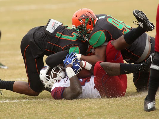 Rattler defenders tackle a SC State player.jpg