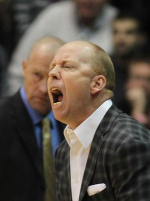 Cincinnati's coach Mick Cronin directs players against San Diego State in the first half of their NCAA college basketball game in Cincinnati Wednesday, Dec. 17, 2014. (AP Photo/Tom Uhlman)