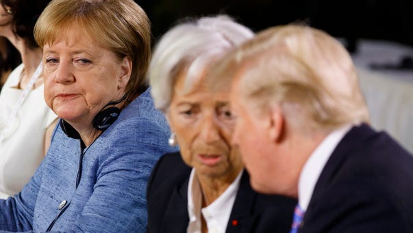 German Chancellor Angela Merkel watches as President