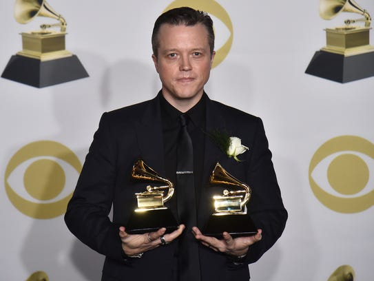 Jason Isbell poses in the press room with the best