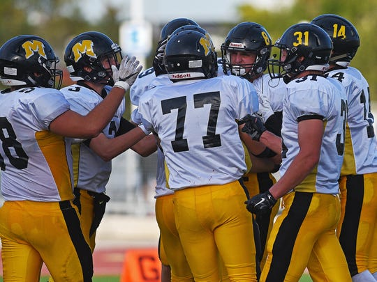 Mitchell players react after Spencer Neugebauer (8)