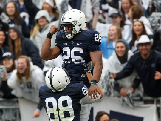 Penn State Nittany Lions running back Saquon Barkley (26) celebrates with tight end Mike Gesicki (88) after scoring a touchdown during the second quarter against the Akron Zips at Beaver Stadium. Penn State defeated Akron 52-0.