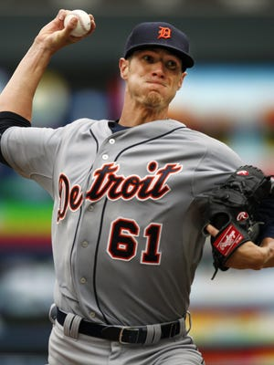 Detroit Tigers starting pitcher Shane Greene throws against the Minnesota Twins on Sunday, July 12, 2015, at Target Field in Minneapolis.