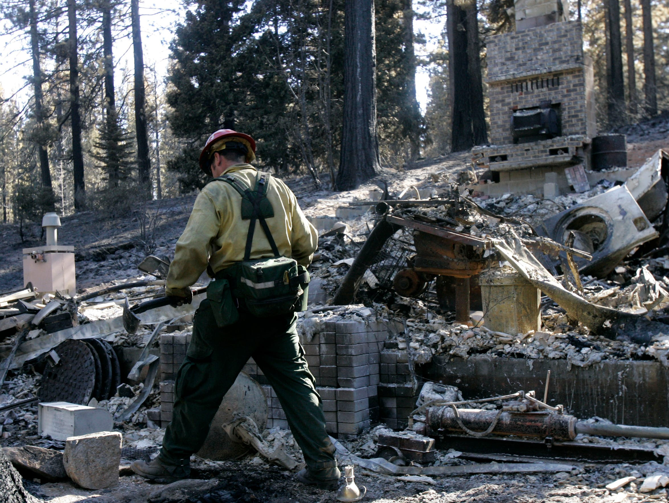 Steve Meadows of the U.S. Forest Service does mop up