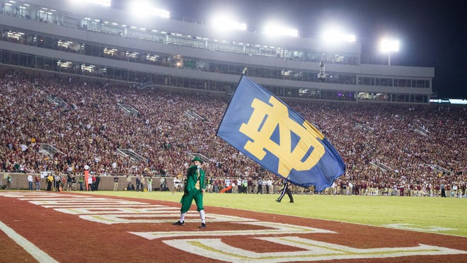 The Notre Dame Fighting Irish Leprechaun waves a flag after a touchdown in the third quarter against Florida State at Doak Campbell Stadium.