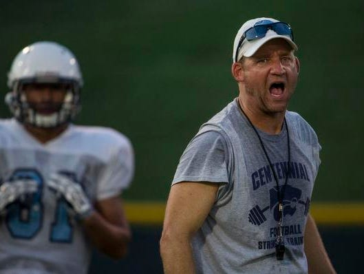 Centennial Coach Brian Rector gets his team moving during Monday's evening practice.
