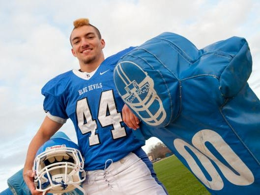Doug Goldsmith is a linebacker for the Shore Regional football team. Photo was taken in West Long Branch on Monday, November 30, 2015. / Russ DeSantis / For the Asbury Park Press / Slug: ASB 1203 FB defensive game ball