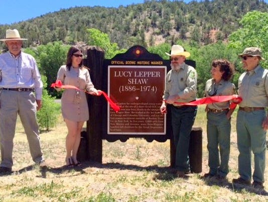 ribbon cutting at historic marker