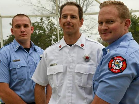 Firefighter/EMT Kyle George, Lt. Michael Abernathy and Firefighter/Paramedic Roman Lane of Titusville Fire Rescue all helped rescue a child who got himself trapped in an arcade claw machine