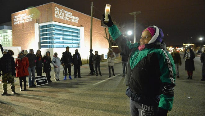 Protesters demonstrate outside the Ferguson, Mo., Police Department on March 4, 2015.
