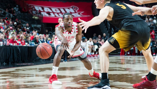 UL senior Johnathan Stove, who has accepted a sixth-man role, passes the ball in a win over Appalachian State last week.