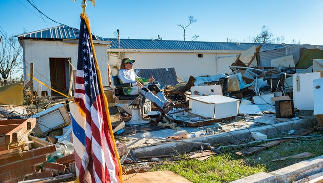 William Gay takes a break while helping a friend to find personal belongings in barber shop on hwy 98 in Panama City, FL after  Hurricane Michael caused widespread damage. Friday, Oct. 12, 2018.