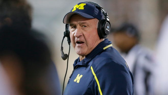Michigan defensive coordinator Greg Mattison walks the sidelines during a game against Michigan State in East Lansing on Oct. 25, 2014.
