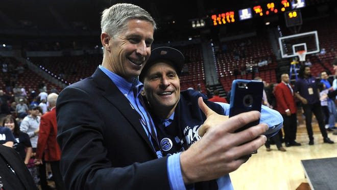 Nevada head coach Eric Musselman, right, and athletic director Doug Knuth take a selfie after the Wolf Pack won the Mountain West Tournament. Knuth hired Musselman in March 2015.