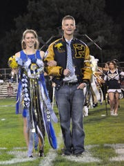 Senior Andi Harrelson  is escorted by Senior Landon Taylor at the Ruidoso Homecoming Oct. 2.