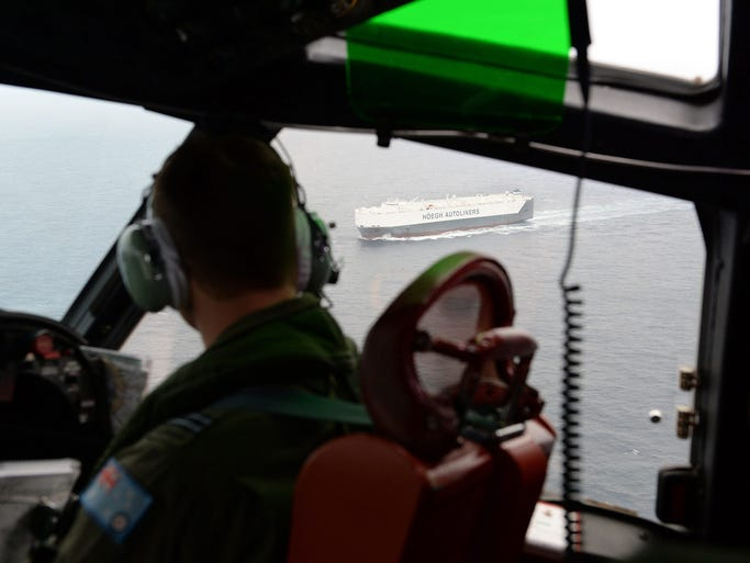 A Royal Australian Air Force AP-3C Orion search plane passes over the Norwegian car transport ship Hoegh St. Petersburg during a search for the missing Malaysia Airlines jet on March 21 in the Indian Ocean. The Boeing 777 aircraft with 239 people on board disappeared on March 8 on a flight from Kuala Lumpur to Beijing.