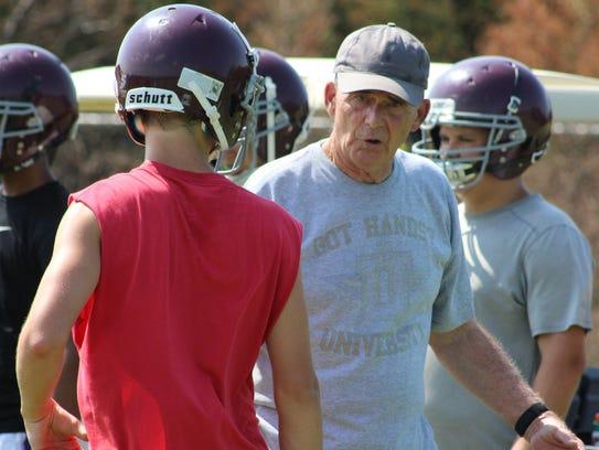 Eagleville quarterbacks coach Alex Robins gives instruction