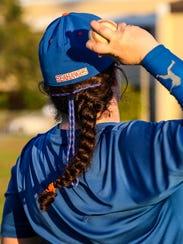 A braid and baseball. Cape Coral High freshman Sophia