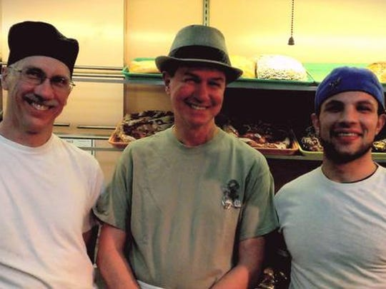 Jackson's bakers, from left, Jim Hand, Jim Symonds and Matt Belk stand in front of a night's work.