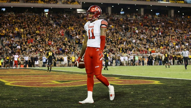 Utah wide receiver Raelon Singleton walks into the end zone for a touchdown against Arizona State late in the second quarter of their game at Sun Devil Stadium.