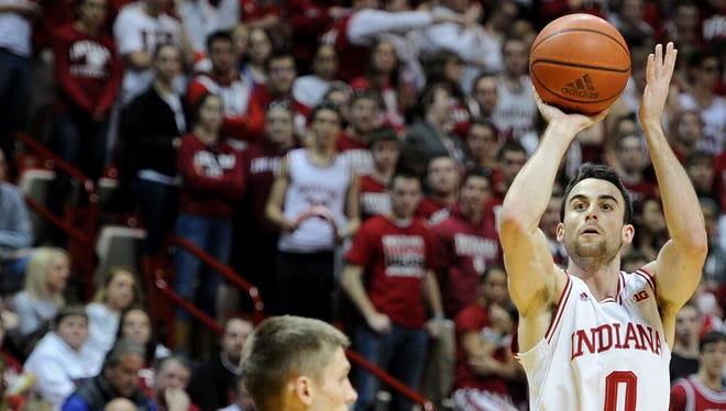 Indiana forward Will Sheehey hits a three-point basket against Iowa inside Assembly Hall, Thursday, February 27, 2014, in Bloomington.