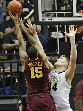 Purdue freshman Isaac Haas (44) defends a shot by Minnesota's Maurice Walker.