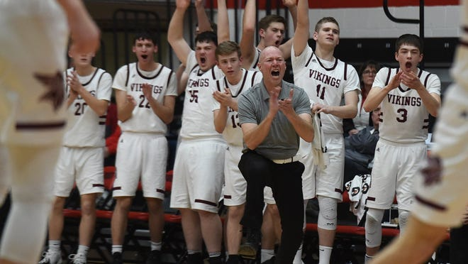 The Waterloo bench celebrates during its regional tournament victory over Newton Falls in March 2020.