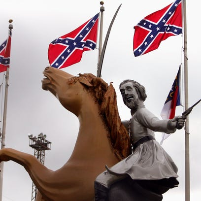 The statue of Nathan Bedford Forrest is surrounded