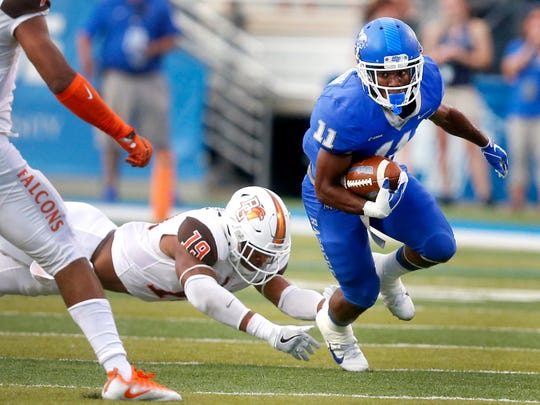 MTSU's Brad Anderson (11) escapes from  Bowling Green's