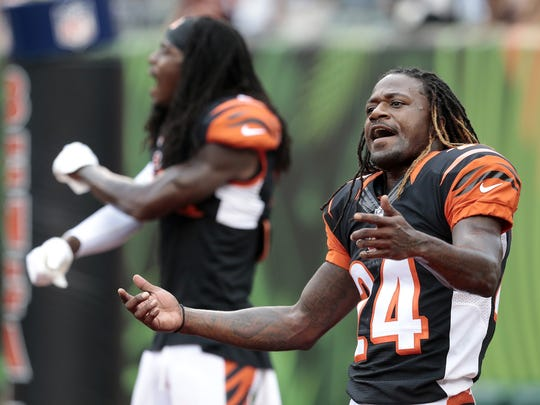 Cincinnati Bengals cornerbacks Adam Jones (24) and Dre Kirkpatrick (27) dance and sing during warmups before kick off of the NFL pre-season game between the Cincinnati Bengals and the Chicago Bears.