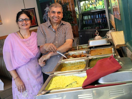 Pinky Kumar handles the front of the house at India Palace and her husband, Sushil, makes the delectable naan behind the scenes.