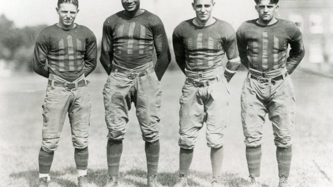 Jack Trice, second to the left, died from injuries sustained in his lone Iowa State game. The school named its football stadium after Trice nearly 20 years ago, and today remains the only Division I FBS stadium named after a Black man.