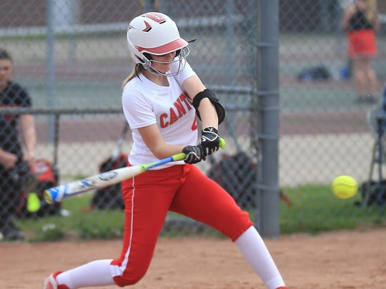Sending a sizzling line drive on its way during Thursday's softball doubleheader against Livonia Churchill is Canton sophomore Izzy Dawson. The Chiefs won both games.