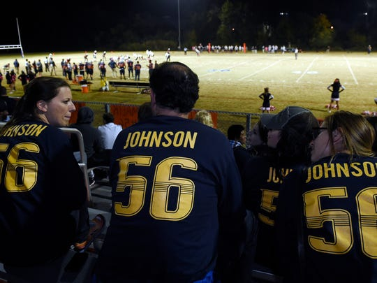 Rebecca King, Chris Parker and Liz Wardlow wear T-shirts supporting Malik Johnson as they watch him play football Friday, Oct. 23, 2015, at Lighthouse Christian School.