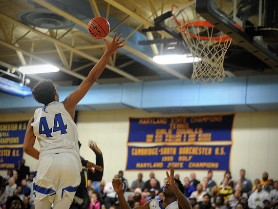 Decatur's Keve Aluma rises to block a shot at the Bayside