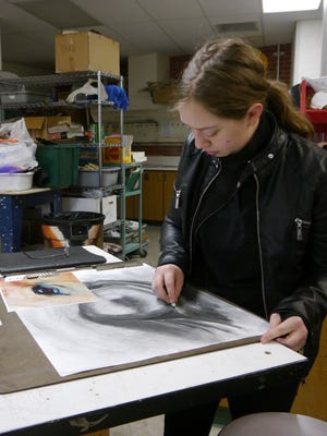 Mackenzie Nice, 18, works on a sketch at C.M. Russell High School.