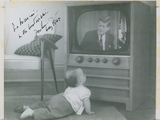 This photo -- of St. Johns baby Marian Holliday watching