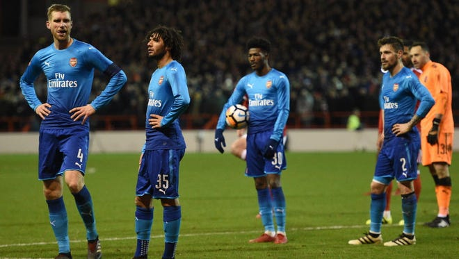 Arsenal players react during their FA Cup loss to Nottingham Forest.