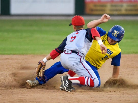 Bombers Ben Wilkerson (5) tags out Flash's Drew Behling (9) at second base in the fourth inning as the Henderson Flash play the Dubois County Bombers in the Ohio Valley League playoffs at B.T. Wayne Field in Henderson Saturday, July 21, 2018.