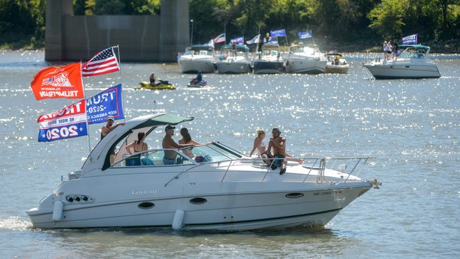 Dozens of boats and jet skis gather Saturday, Sept. 5, 2020 on the Illinois River at the Peoria riverfront for a parade supporting President Donald Trump. The boaters were planning to cruise north to the Rome area before heading back south to Paradice Beach in East Peoria. The event was hosted by the organizers of the annual White Trash Bash.